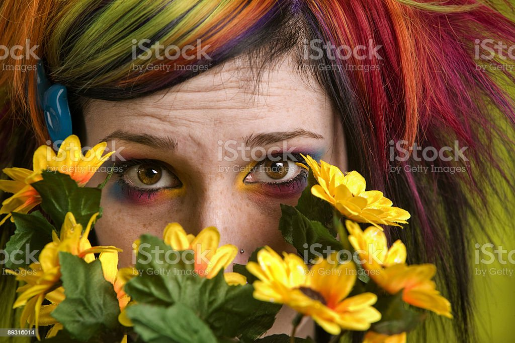 Punk woman with plastic flowers royalty-free stock photo