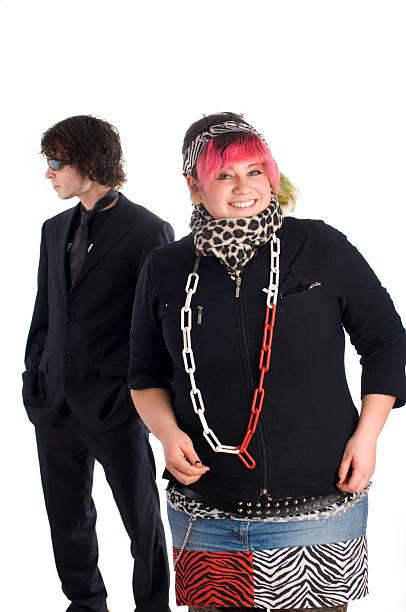 punk music mädchen und business-mann - ausgefallene mode für mollige stock-fotos und bilder