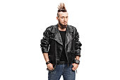 Punker in a black leather jacket isolated on white background