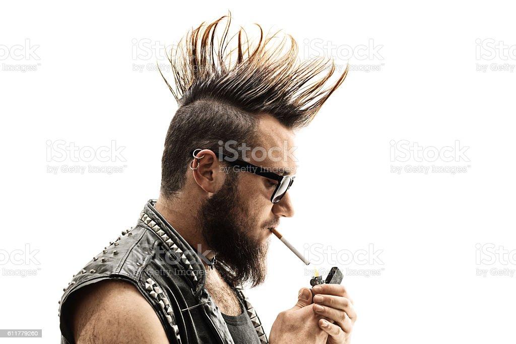 Punker lighting up a cigarette stock photo