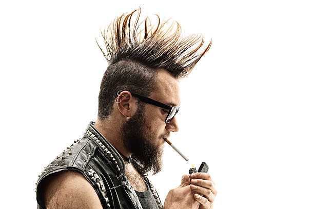 punker lighting up a cigarette - punk music stock photos and pictures