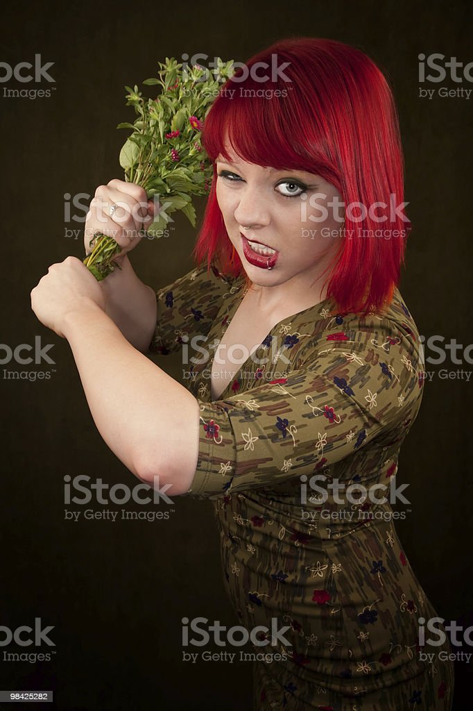 Punky Girl with Red Hair and Flowers royalty-free stock photo