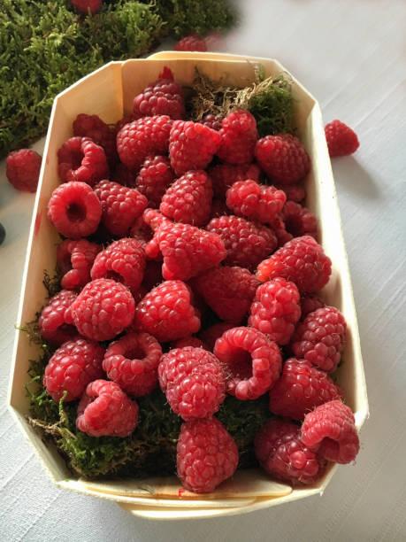 Punnet of raspberries stock photo
