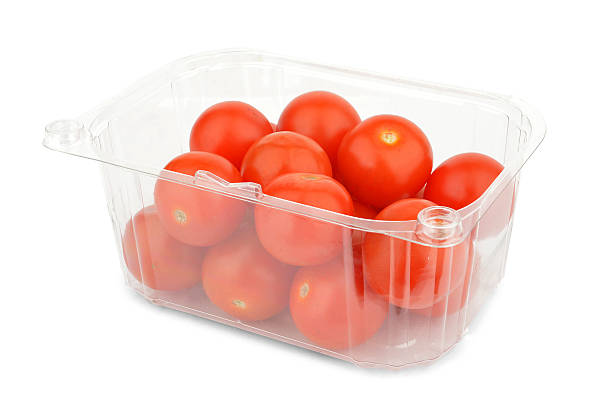 Punnet of Red cherry tomatoes - Stock Image Punnet of Red cherry tomatoes isolated on white background fruit carton stock pictures, royalty-free photos & images