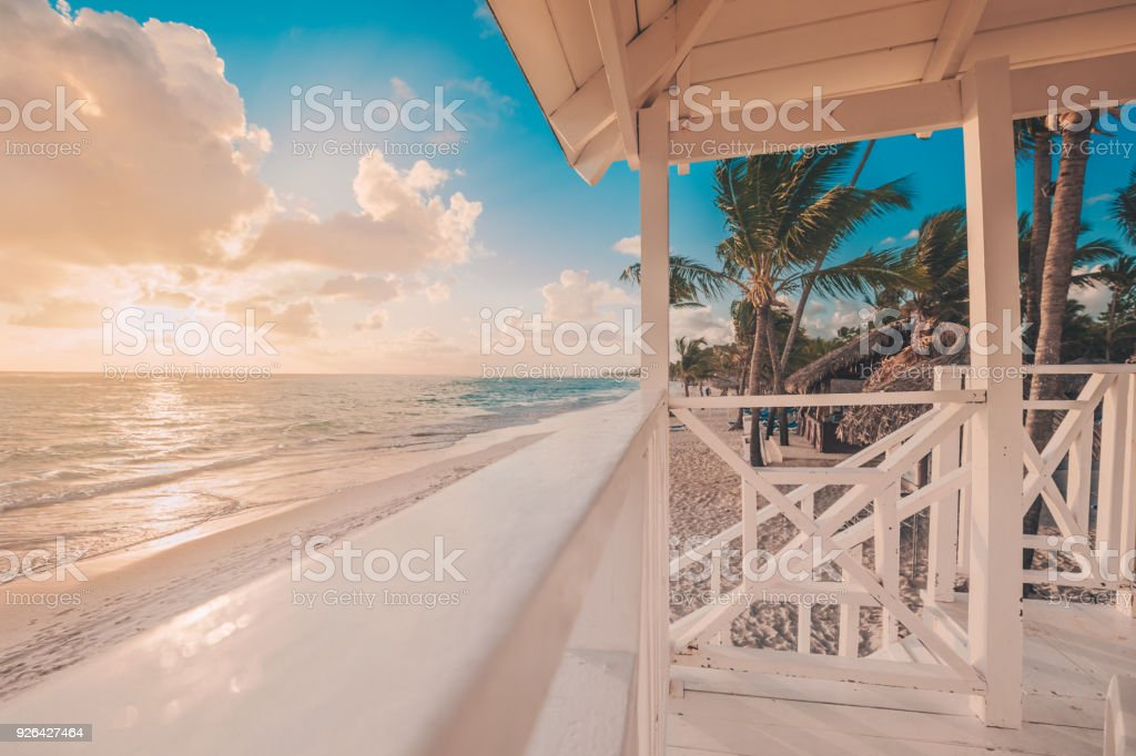 Punta Cana sunrise over Caribbean beach with lifeguard station stock photo