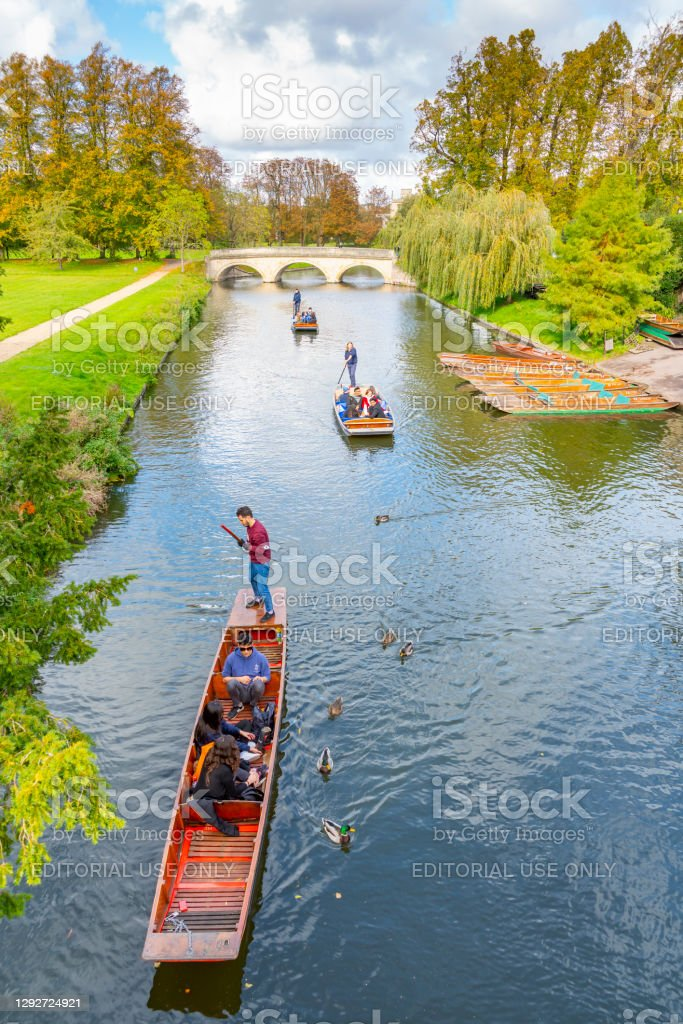 Punting on the River Cam in Autumn River Cam in Autumn viewed towards St John's College Chapel, Cambridge, Cambridgeshire, England, UK with moored punts in the foreground. 2020 Stock Photo