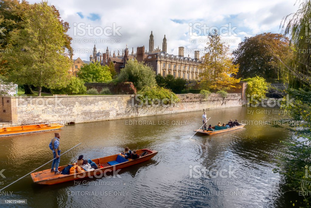 Punting on the River Cam in Autumn River Cam in Autumn viewed towards St John's College Chapel, Cambridge, Cambridgeshire, England, UK with moored punts in the foreground. Kings College is in the background. 2020 Stock Photo