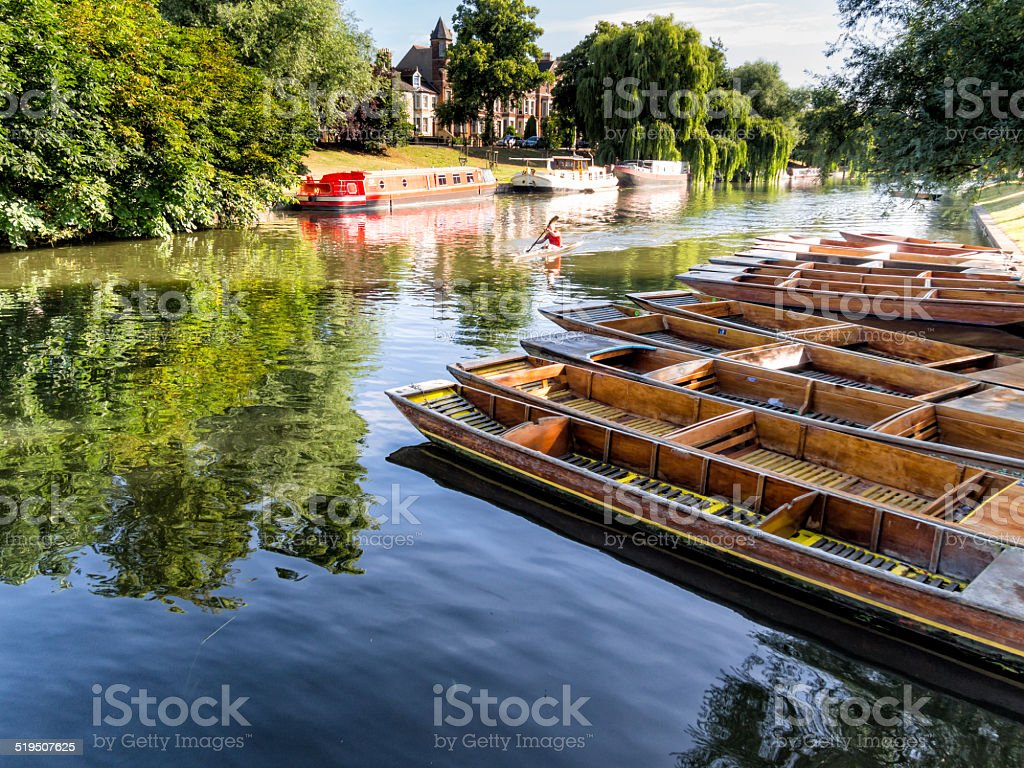 Punts lined up on river in  Cambridge England stock photo