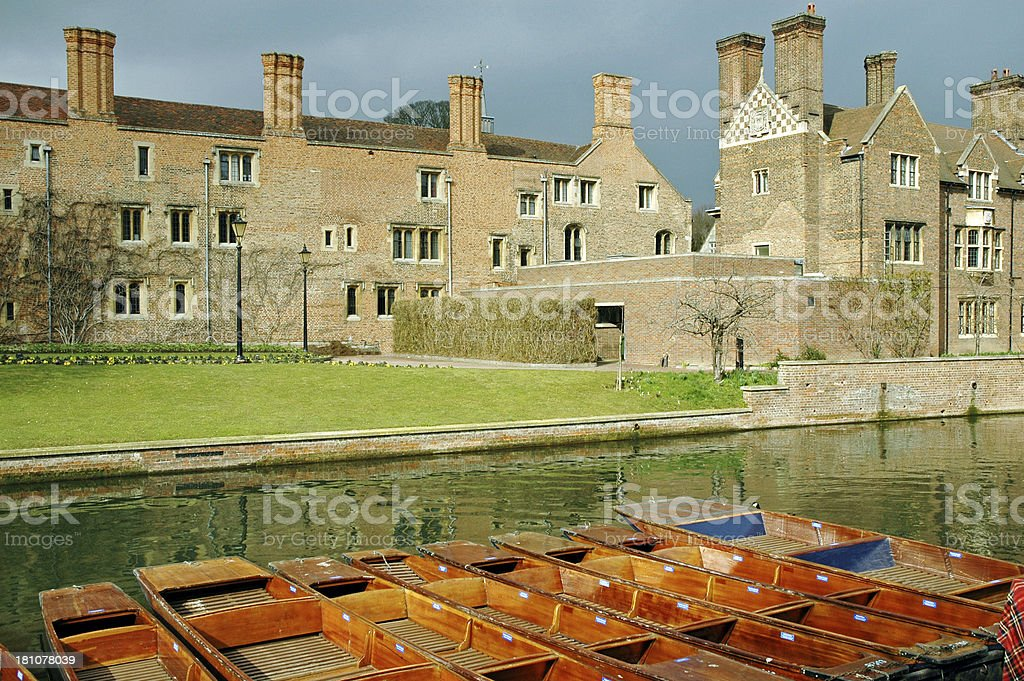 Punts on the Cam River and Magdalene College in Cambridge royalty-free stock photo