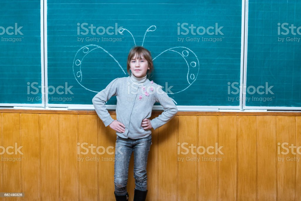 Pupil has a painted school board royalty-free stock photo