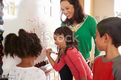 istock Pupil writing on the board at elementary school maths class 515275280