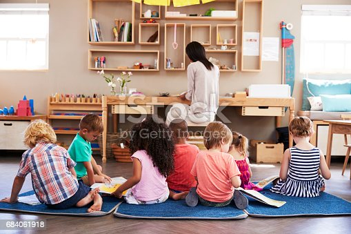 684059604 istock photo Pupils At Montessori School Reading Independently In Classroom 684061918