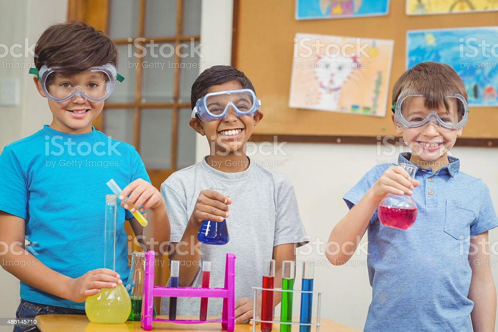 Pupils at science lesson in classroom stock photo