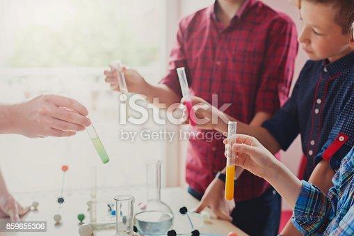 istock Pupils doing biochemistry research, stem education 859655306