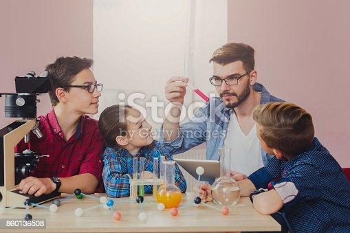 istock Pupils doing biochemistry research, stem education 860136508