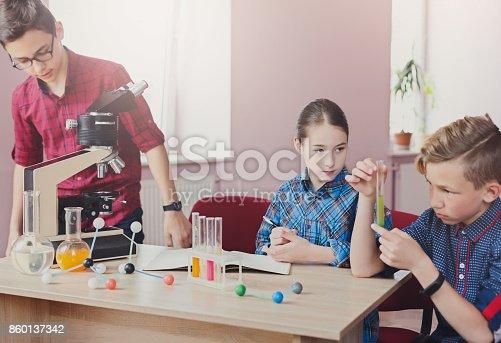 istock Pupils doing biochemistry research, stem education 860137342