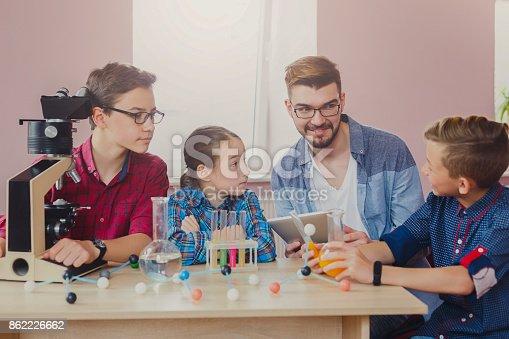 istock Pupils doing biochemistry research, stem education 862226662