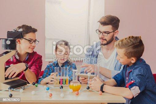 istock Pupils doing biochemistry research, stem education 862620620