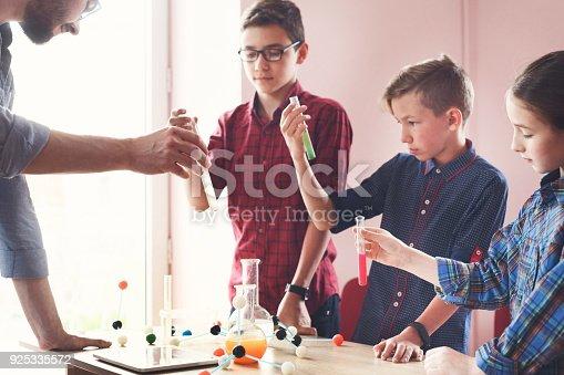 istock Pupils doing biochemistry research, stem education 925335572