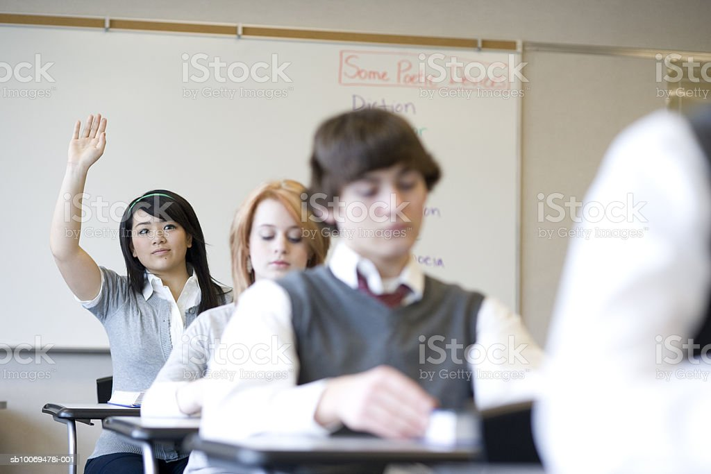 Pupils (15-18) in school classroom, differential focus royalty-free stock photo