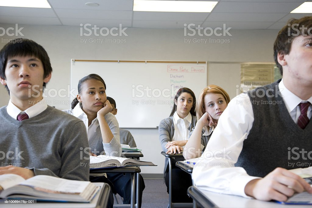 Pupils (14-18) in school classroom royalty free stockfoto