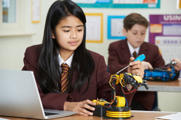 pupils in science lesson studying robotics - private school stock photos and pictures