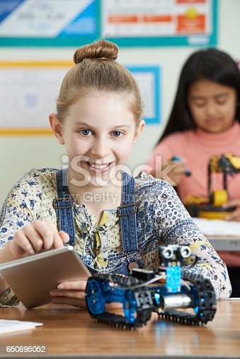 1016655140 istock photo Pupils In Science Lesson Studying Robotics 650695052