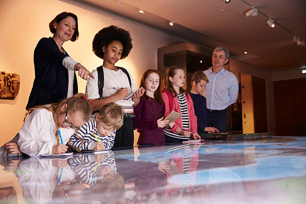 Pupils On Trip To Museum Looking At Map And Making Pupils On Trip To Museum Looking At Map And Making Notes field trip stock pictures, royalty-free photos & images