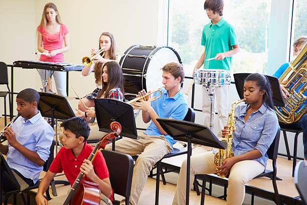 Pupils Playing Musical Instruments In School Orchestra stok fotoğrafı