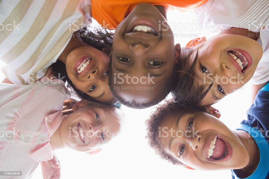 Pupils standing in a circle stock photo