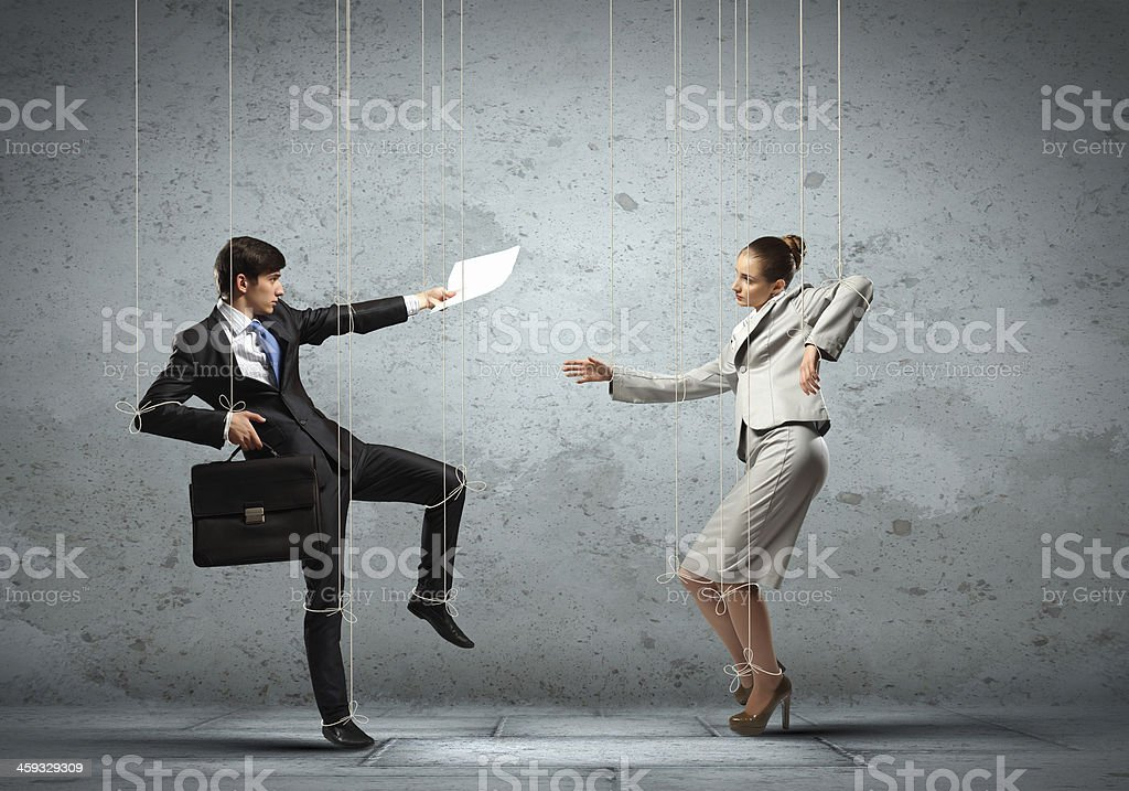 Puppet businesspeople stock photo