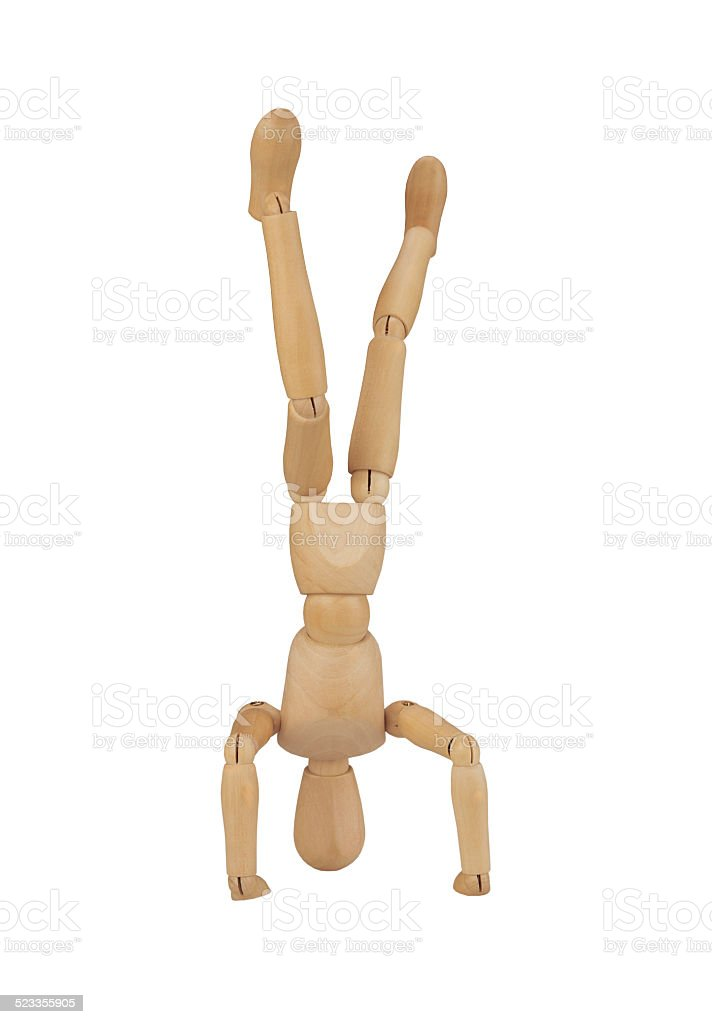 puppet in handstand, isolated on white background stock photo