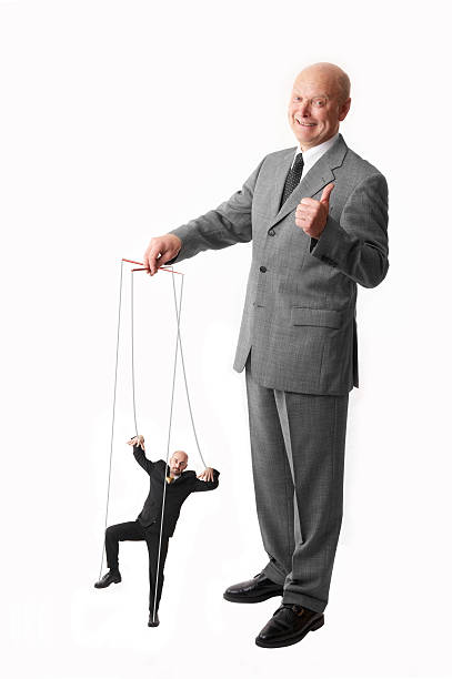 puppet on a string boss having his employee on a string puppet stock pictures, royalty-free photos & images