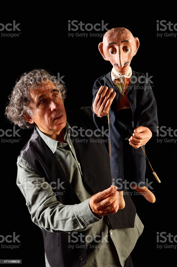 Puppeteer and  the Black sea people stock photo