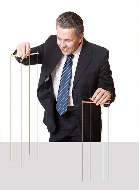 Puppeteer Concept Puppeteer. Authority General Manager. Concept puppet stock pictures, royalty-free photos & images