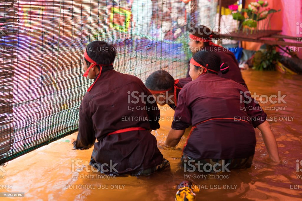 Hanoi, Vietnam - Feb 7, 2015: Puppeteers hiding behind the blind in dark room to perform a puppetry show at Vietnamese lunar new year festival organized at Vinschool, Vinhomes Times City, Minh Khai stock photo