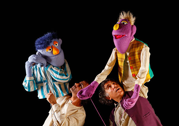 Puppeteers Puppeteers with their puppets on show,  puppet stock pictures, royalty-free photos & images