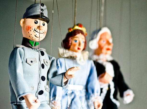 Puppets on a string Puppets on a string puppet stock pictures, royalty-free photos & images