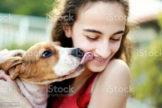 Puppy kissing teenage girl picture id1131170678?b=1&k=6&m=1131170678&s=612x612&h=aylhv7btjpc3bhidf8asedbjzpuhifllya0vxj i074=