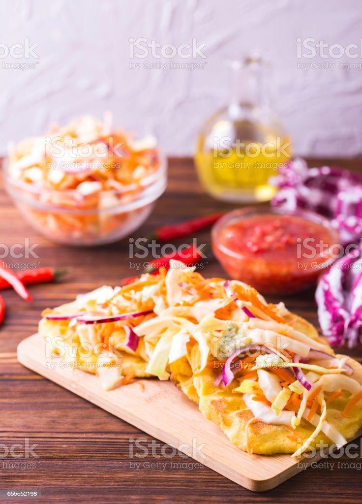 Pupuseria, pupusa - corn flour tortillas with cheese and beans stock photo