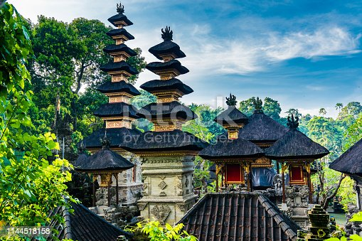 Pura Gunung Lebah Temple in Ubud. Buddhist temple in a deep tropical forest. Aerial drone shot.