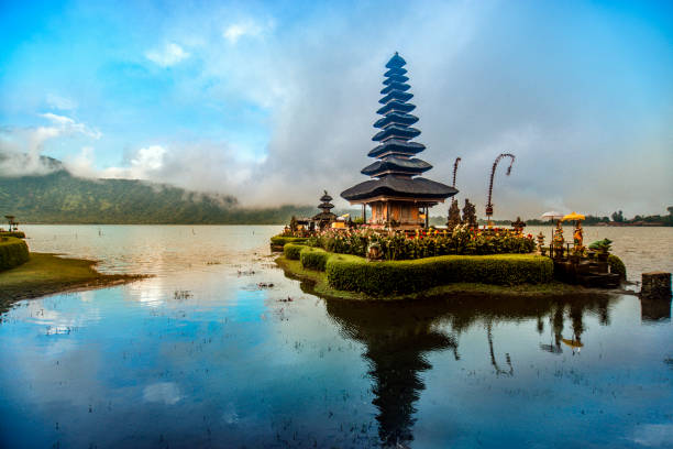 Pura Ulun Danu Beratan the Floating Temple in Bali at Sunset Pura Ulun Danu Beratan the Floating Temple in Bali at Sunset, Indonesia indonesia stock pictures, royalty-free photos & images