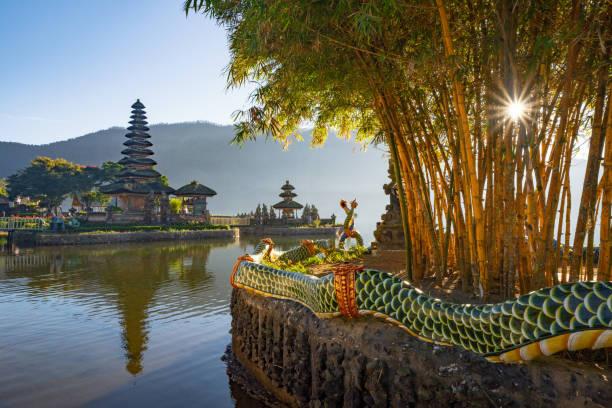 Pura Ulun Danu Bratan Temple at sunrise, a Hindu temple with mountain, lake, in Bali island, Indonesia. Natural landscape background. stock photo