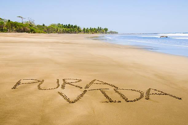 Pura Vida written on Costa Rican beach stock photo