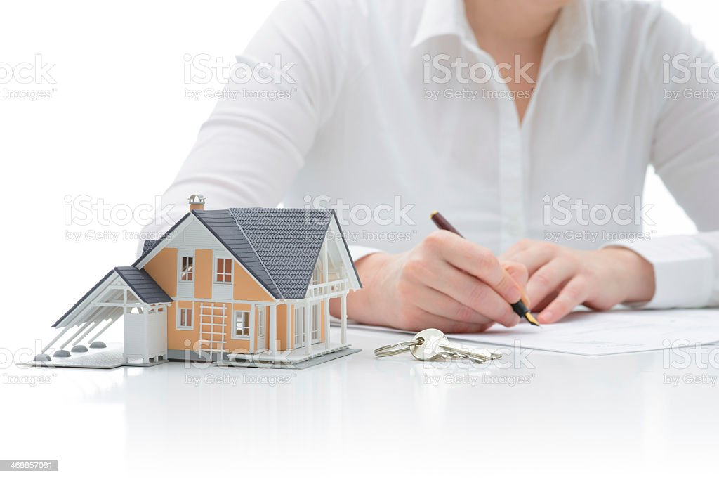 Purchase agreement for hours with model home stock photo