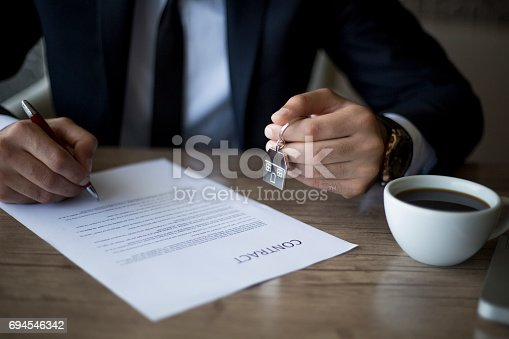 828544458istockphoto Purchase agreement for house 694546342