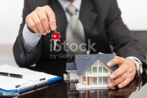 828544458istockphoto Purchase agreement for house 865352328