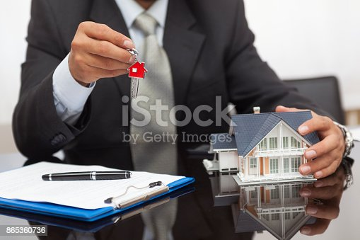 828544458istockphoto Purchase agreement for house 865360736