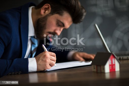 475902363 istock photo Purchase agreement for new house 1126516859