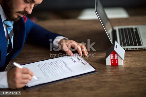 828544458istockphoto Purchase agreement for new house 1126517097